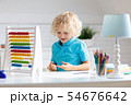 Child with abacus doing homework after school. 54676642