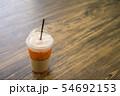 Thai iced tea on wood table in cafe. 54692153