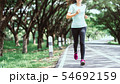 Young asian woman running on road in the nature. 54692159