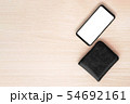 Smartphone and wallet on wood table background. 54692161