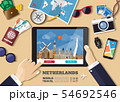 Hand holding smart tablet booking travel 54692546