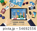 Hand holding smart tablet booking travel 54692556