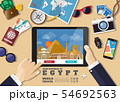 Hand holding smart tablet booking travel 54692563