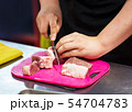 chef cutting beef meat, cutting raw meat on board 54704783