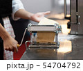 Chef making pasta with a machine, home made fresh 54704792