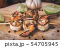 Skewer shrimps burnt grilled with spice seasoning. 54705945