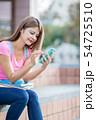 携帯 携帯電話 女性の写真 54725510