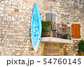 A canoe hangs on the balcony in Ruoms 54760145