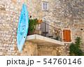 A canoe hangs on the balcony in Ruoms 54760146