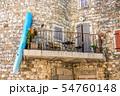 A canoe hangs on the balcony in Ruoms 54760148