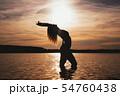 Happy Carefree Woman Enjoying Beautiful Sunset on the Beach 54760438