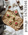 Watermelon slice cookies recipe on background.. 54763046