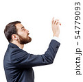 Businessman pointing to something or touching by forefinger. 54779093
