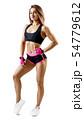 Young woman in sportswear demonstrate her muscular body. 54779612