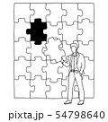 businessman holding a piece of jigsaw puzzle 54798640