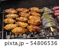 Mixed assortment of marinated meat, chicken, and prawns grilling on hot coals on a BBQ 54806536