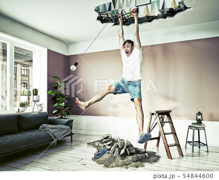 broken ceiling and a man hanging in the hole. 54844600