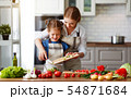 happy family mother with child girl preparing 54871684