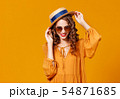 beautiful young curly woman in summer hat and 54871685