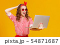 funny cheerful woman with laptop on yellow 54871687