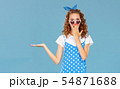 beautiful funny girl on colored blue background. 54871688