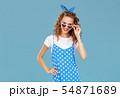 beautiful funny girl on colored blue background. 54871689