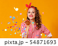cheerful funny young woman with festive confetti 54871693