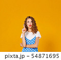 beautiful funny girl on colored yellow background 54871695