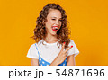 beautiful funny girl on colored yellow background 54871696