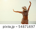 happy tourist girl with backpack and hat on sea 54871697