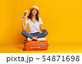 concept of travel. happy woman girl with suitcase 54871698