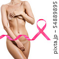 Naked woman in front of big pink ribbon. 54889895