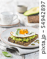 Sandwich with avocado and egg 54942897