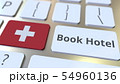 BOOK HOTEL text and flag of Switzerland on the buttons on the computer keyboard. Travel related 54960136