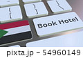 BOOK HOTEL text and flag of Sudan on the buttons on the computer keyboard. Travel related conceptual 54960149
