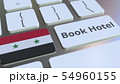 BOOK HOTEL text and flag of Syria on the buttons on the computer keyboard. Travel related conceptual 54960155