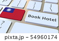 BOOK HOTEL text and flag of Taiwan on the buttons on the computer keyboard. Travel related 54960174
