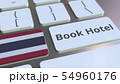 BOOK HOTEL text and flag of Thailand on the buttons on the computer keyboard. Travel related 54960176