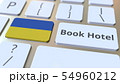 BOOK HOTEL text and flag of Ukraine on the buttons on the computer keyboard. Travel related 54960212