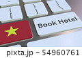 BOOK HOTEL text and flag of Vietnam on the buttons on the computer keyboard. Travel related 54960761