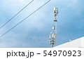 Cellular phone antennas on a building roof. 54970923