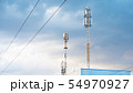 Cellular phone antennas on a building roof. 54970927