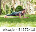 Beautiful young woman doing stretching yoga  54972418