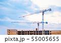 Construction cranes on blue sky background 55005655