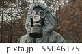Man wearing a WWII Hazmat suit and gas mask carrying a counter in his hands as he scans for 55046175