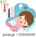 暑くて寝苦しそうな若い女性 55048599