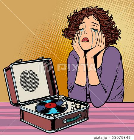 woman listening to sad music, retro vinyl record player 55079342