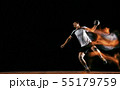 Young handball player against dark studio background in mixed light 55179759