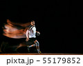Young handball player against dark studio background in mixed light 55179852