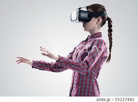 Girl in mask experiencing virtual reality as new entertainment device 55227882